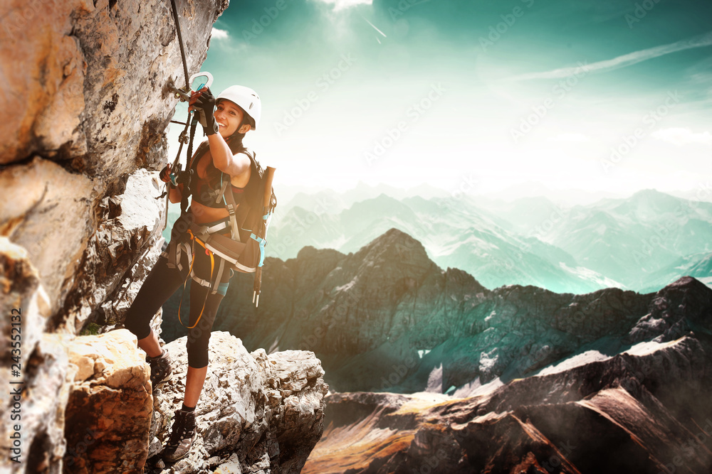 Fototapety, obrazy: Girl climbing on a Via Ferrata