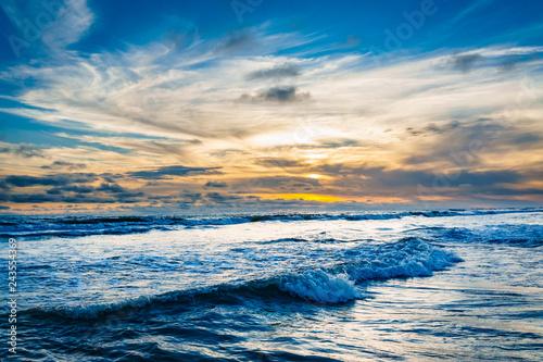 Fotografiet  Beutiful sunset in the pacific, La Barra, Colombia.