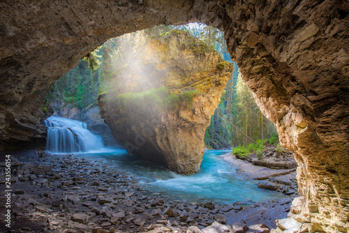 Johnston Canyon cave in Spring season with waterfalls, Johnston Canyon Trail, Alberta, Canada