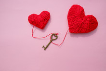 Bronze Skeleton Key And Pink Knitted Hearts,antique Rustic Keys On Pink Background. Happy Valentine's Day Card.symbol Of Love. Hobby Concept.heartbeat,feelings, Romance Concept.Copy Space.