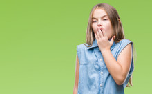 Young Beautiful Girl Over Isolated Background Bored Yawning Tired Covering Mouth With Hand. Restless And Sleepiness.