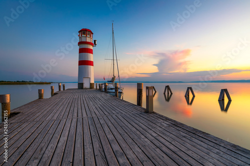 Foto auf Leinwand Leuchtturm Lighthouse at Lake Neusiedl at sunset near Podersdorf, Burgenland, Austria