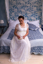 Regency Lady Sitting On Four-poster Bed