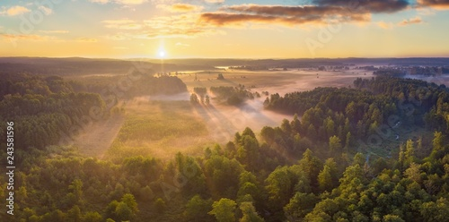 Foto auf Leinwand Landschaft Beautiful foggy morning landscape photographed from above