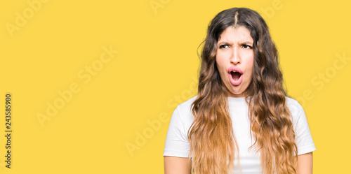 Photo  Young beautiful woman wearing casual white t-shirt In shock face, looking skepti