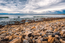 Rocky Shore With Cloudy Sky
