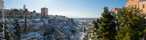 Valokuva  Panoramic View of the Gravina of the Town of Massafra, Covered by Snow on Blue S