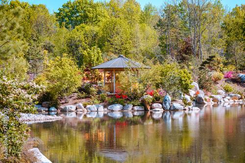 Fotografie, Obraz  Landscape shot of a gazebo along the pond in the japanese garden at the Frederik