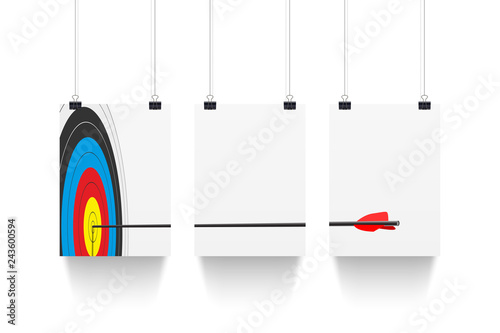Photo  Three white paper sheets hanging on paper clips with archery target and arrow isolated on white background