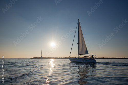 Sailboat leaving Channel Islands harbor in Oxnard California United States