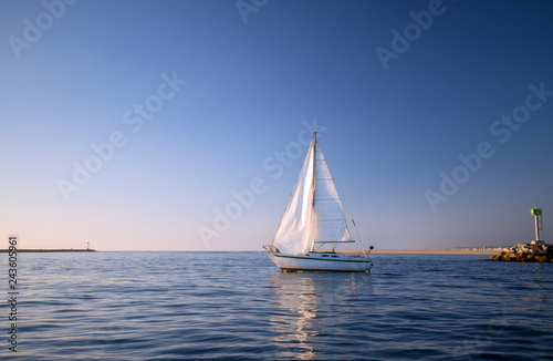 Recreational Sailboat leaving Channel Islands harbor in Oxnard California United States
