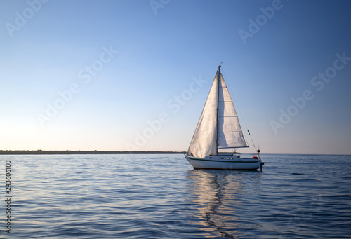 Sailboat reflecting in water when leaving Channel Islands harbor in Oxnard California United States