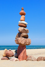 Rock Zen Pyramid Of Colorful Pebbles On The Background Of The Sea. Concept Of Balance, Harmony And Meditation.