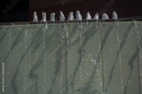 Spoed Foto op Canvas Licht, schaduw The fountains gushing sparkling water in a poo