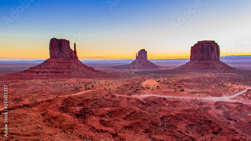 Photo Stands Magenta Sunrise at Monument Valley, UT.