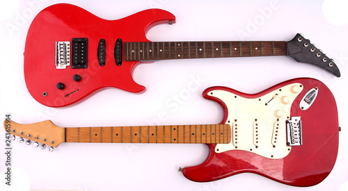 Red electric guitar with white backdrop. Canvas Print