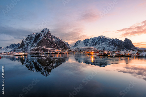 Wall Murals Northern Europe Fishing village with snow mountain at sunrise