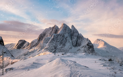 Fotografie, Tablou Majestic mountain range with snowfall at sunrise morning