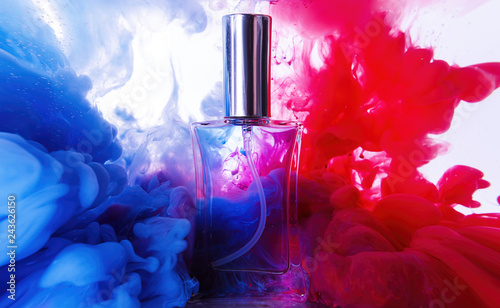 Fototapeta Bottle of perfume in color smoke obraz