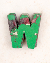 A Pile Of Old  Painted Wooden Letter W