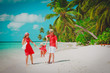 happy family with kid playing on tropical beach