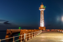 Evening At The West Pier Lighthouse In Whitby, North Yorkshire, England, UK