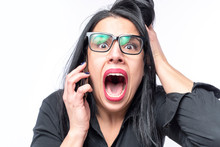 Afraid And Shocked Young Business Woman Receiving Bad News Over Her Cell Phone