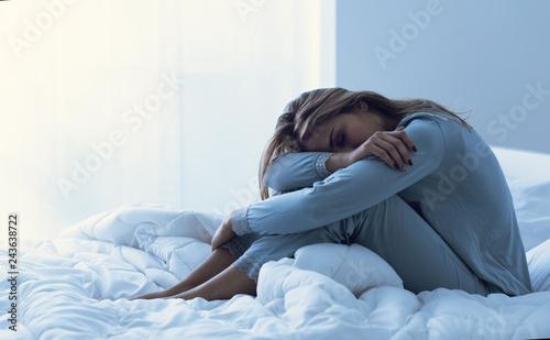 Obraz Depressed woman awake in the night - fototapety do salonu