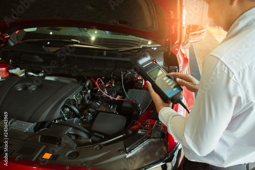 Wallpaper Mural Man inspection holding Battery Capacity Tester Voltmeter.