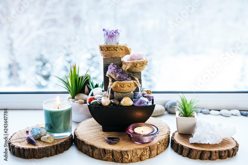 Fotografie, Obraz  Relaxing spiritual Feng Shui altar set with nature, water and fire element