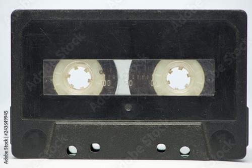 Fotografía  A black cassette tape on a white background
