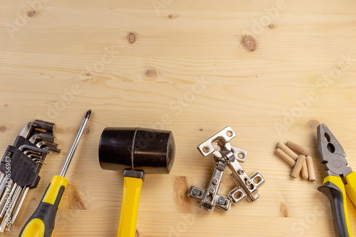 Fotografie, Tablou  Furniture assembly components and tools arranged in a still life on a table
