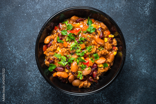 Fotografie, Obraz  Chili con carne from meat and vegetables on black table top view