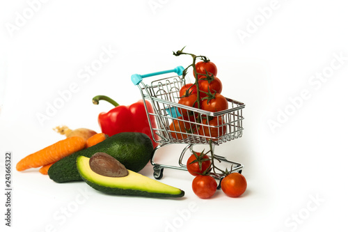 Poster Diet concept. Fresh vegetables in a shopping cart. Raw vegetables. Healthy food. isolated on white background