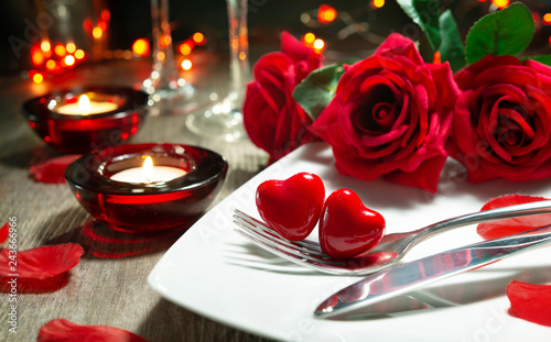Festive table place setting for Valentines day dinner