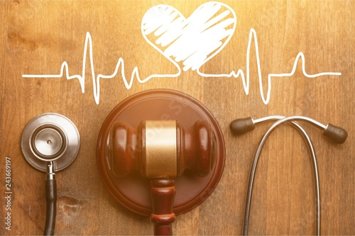 Cuadros en Lienzo Gavel and stethoscope on wooden background, symbol photo for