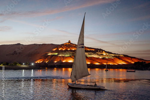 Sunset in Aswan Egypt with Felucca boat on the Nile river Canvas Print