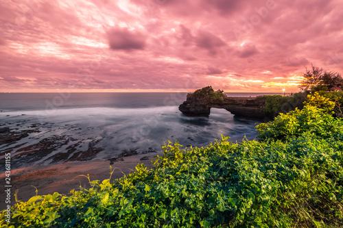 Foto op Aluminium Koraal Colorful Sunset at rocky coast Pura Batu Bolong, Tanah Lot temple, Bali, Indonesia.