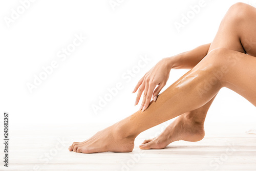 cropped shot of african american woman touching leg with sugar wax on white Canvas Print