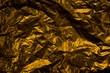 Glänzende Gold Folie als Hintergrund Textur