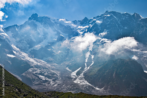 Fotografie, Obraz  Panoramic view of the imposing east face of Monte Rosa against the light, above Macugnaga in Piedmont, Italy