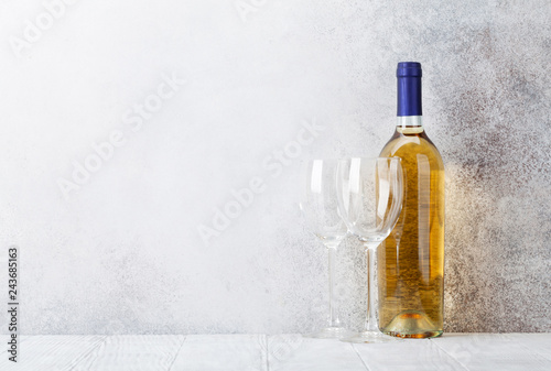 White wine bottle and glasses