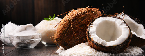 Composition with bowl of shredded coconut and shells