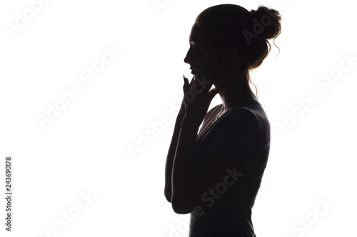 Fotografia, Obraz  silhouette of a calm young woman on a white isolated background, figure of girl