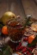 Fragrant fruit tea with tangerines, dried lemons and rosemary on a wooden table. Country style.