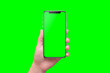 canvas print picture - Modern smart phone in hand close-up. Isolated screen and background in green.