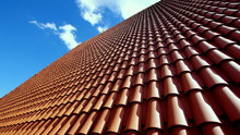 Sloping Roof Of The Family House Covered With Red Tiles