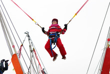 Little Girl Bungee Jumping On ...