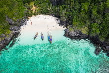 Adventure Style Hi Season Thai And Foreign Tourists Long Tail Boat And Driving See Coral  On Phi Phi Island Kra Bi Thailand Aerial Top View From Drone