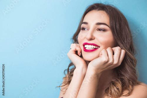 Fototapeta Smiling woman with beautiful white teeth. Portrait of a happy girl with clean skin and smooth teeth.  obraz na płótnie